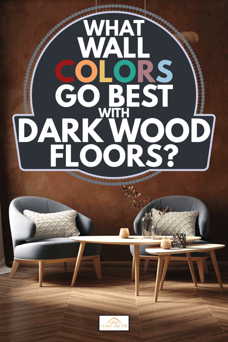 dark room with chairs, coffee table and dry grass bouquet hanging above, old grunge brown wall. What Wall Colors Go Best With Dark Wood Floors
