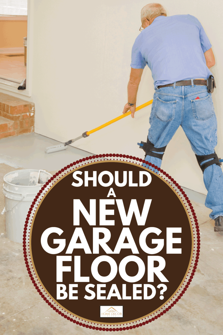man applying sealant on garage floor using roller. Should A New Garage Floor Be Sealed