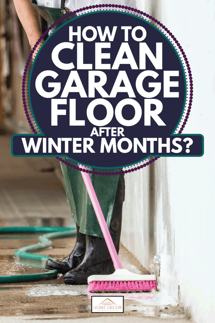 man scrubbing concrete floor using brush with long handle. How To Clean Garage Floor After Winter Months