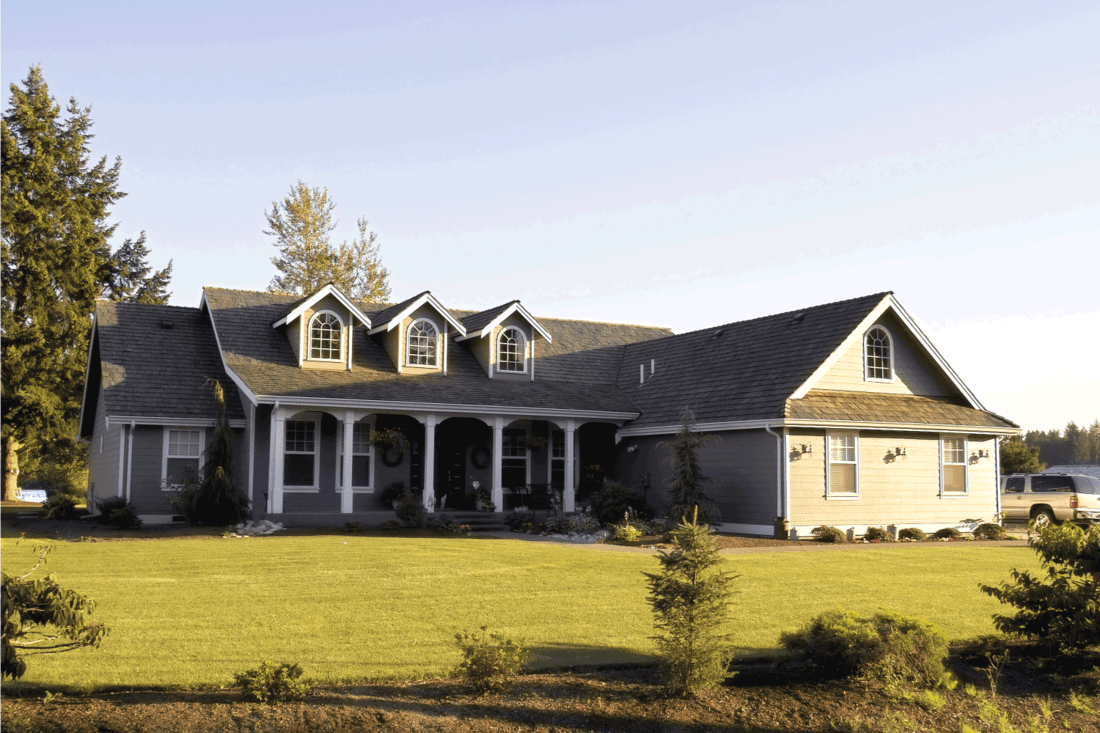modern country home at sunset. farmhouse ranch