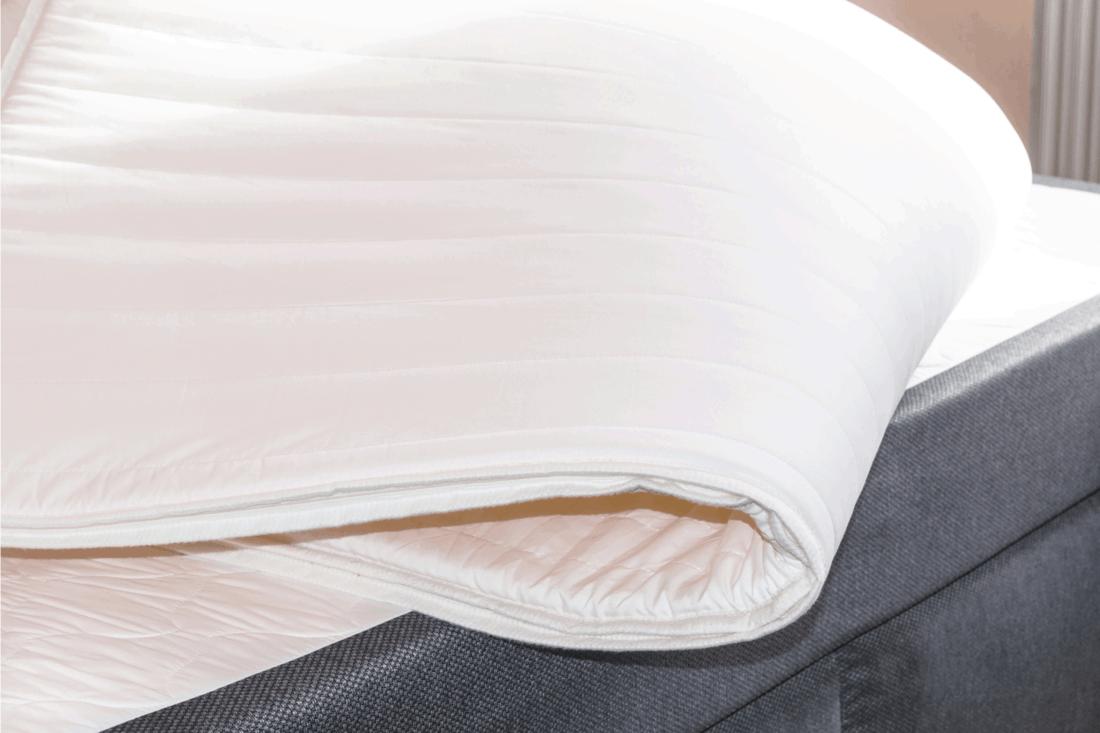 white mattress on top of box spring