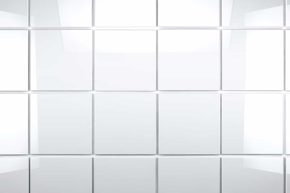 white tile wall of a bathroom