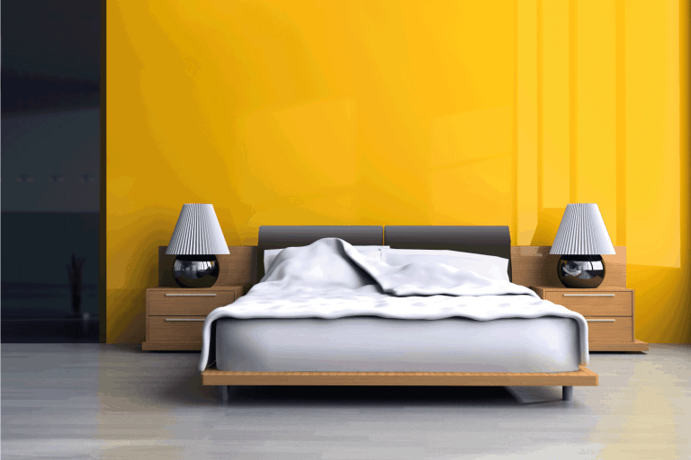 yellow bedroom with low rise bed