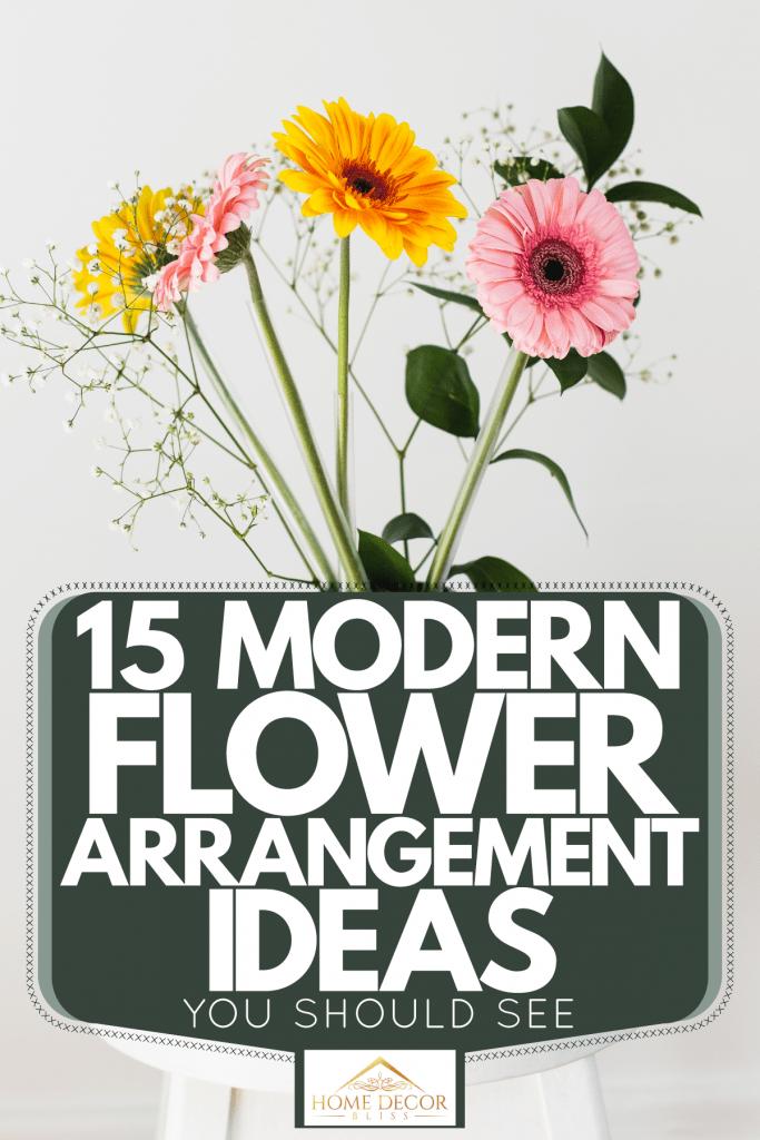 A gorgeous flower arrangement using gerbera daisy on a white background, 15 Modern Flower Arrangement Ideas You Should See