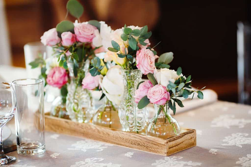 A gorgeous decorative flower design for the table using pink peonies and white roses