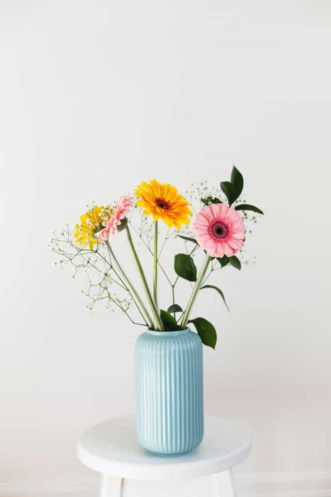 A gorgeous flower arrangement using gerbera daisy on a white background