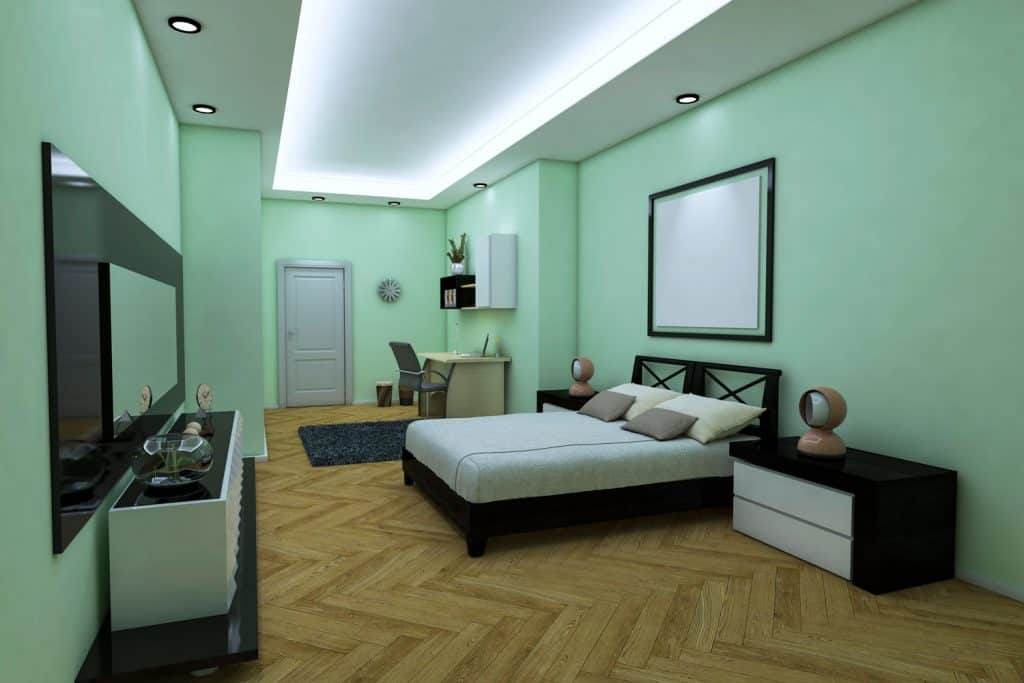 A gorgeous mint green colored basement bedroom with dark colored furniture's and wood tiles