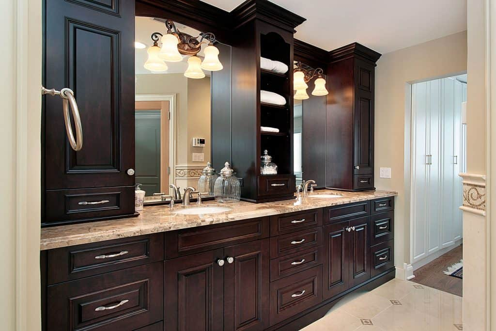 A long span rustic bathroom cabinet matched with marble countertop