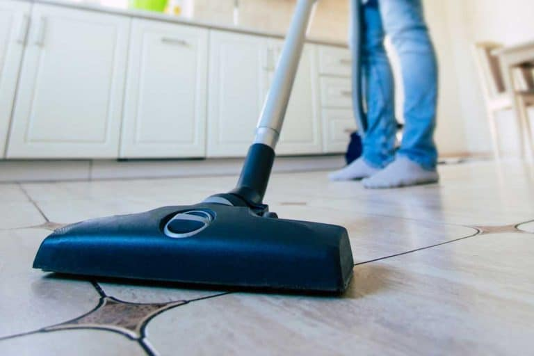 A man cleaning the floor in domestic kitchen, Can You Use A Carpet Cleaner On Tile?