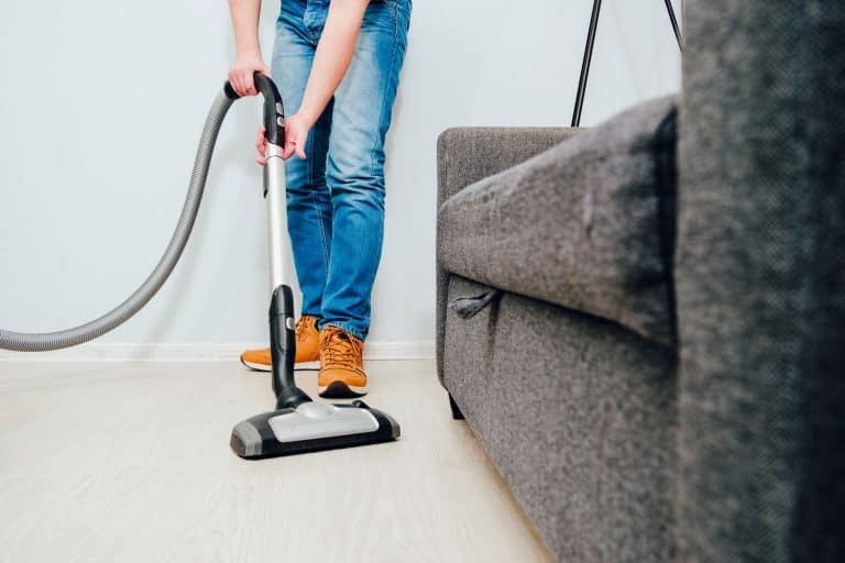 A man uses a vacuum cleaner to clean the apartment. Concept of caring for the interior of the apartment, cleaning. Help husbands in housekeeping, Can You Use Bleach Or Other Cleaners In A Bissell Crosswave?