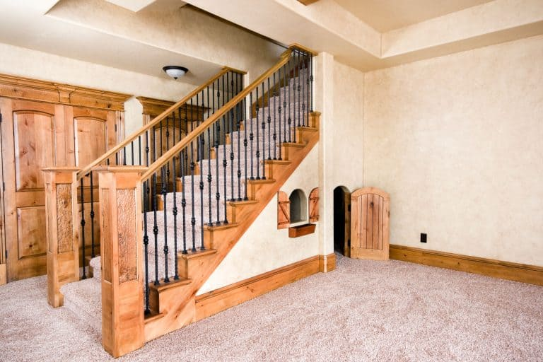 A rustic inspired basement with matching stairs and flooring, Should The Basement Floor Match The Upstairs?