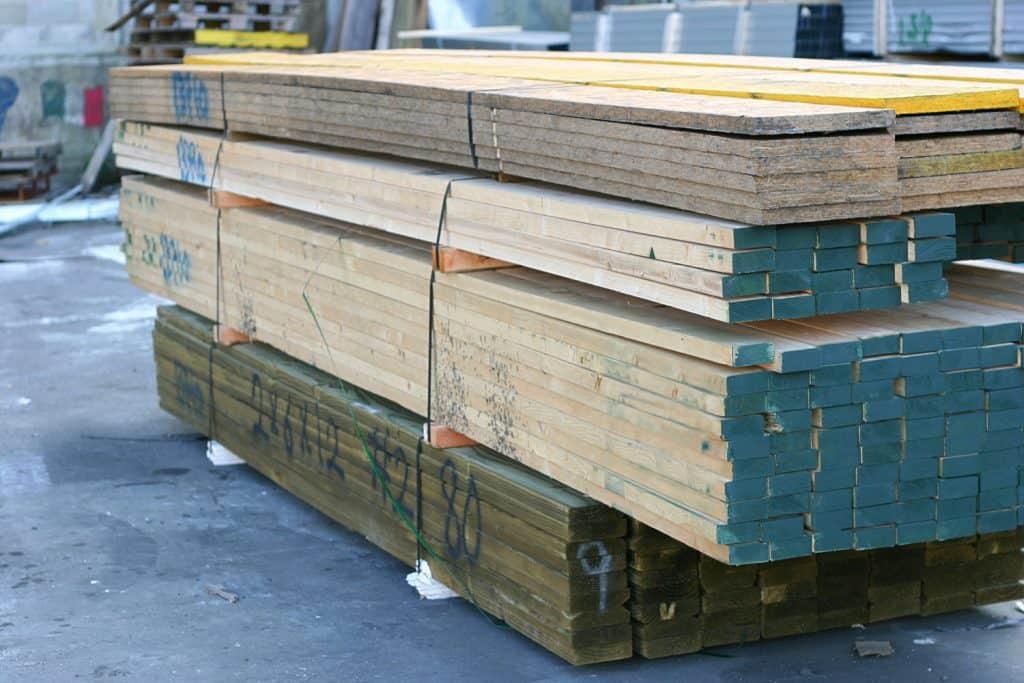 A stockpile of pressure treated wood