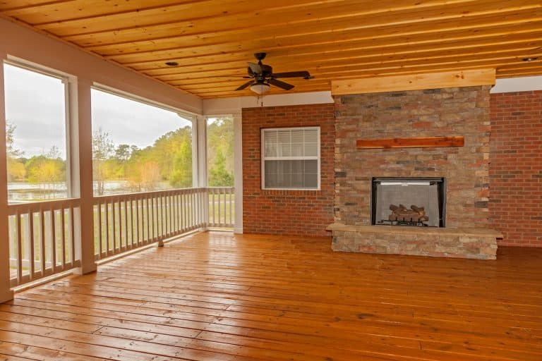 A stunning and cozy empty log cabin with a fireplace on the middle, Can You Use Pressure-Treated Wood For Framing?