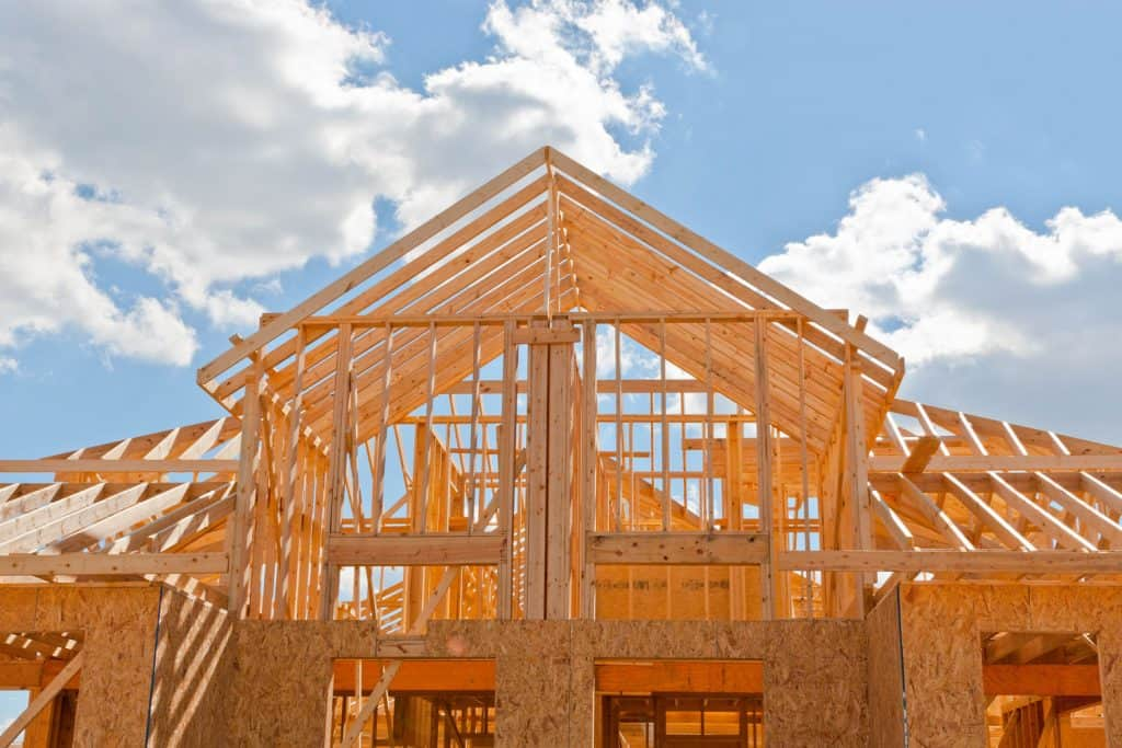 A wooden framing of a house under construction
