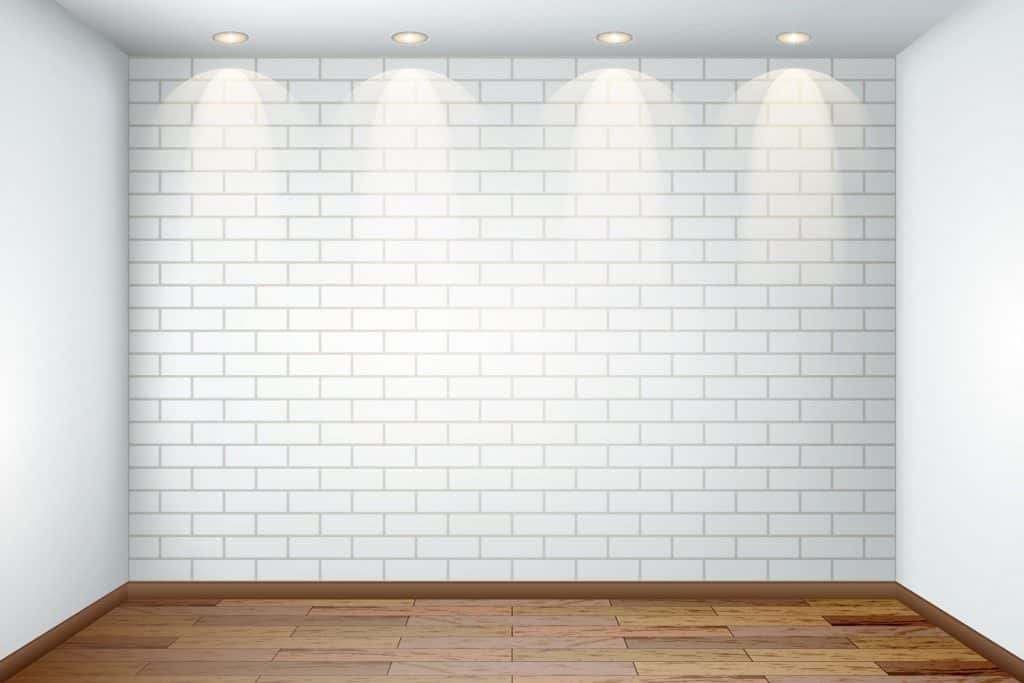 An empty space with white brick wall