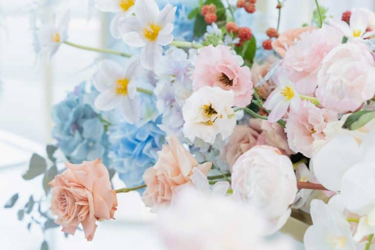 Beautiful flower composition by florist on wedding for bride and groom from roses, tulips, peonies, and orchids on the table, 15 Gorgeous Orchid Flower Arrangements