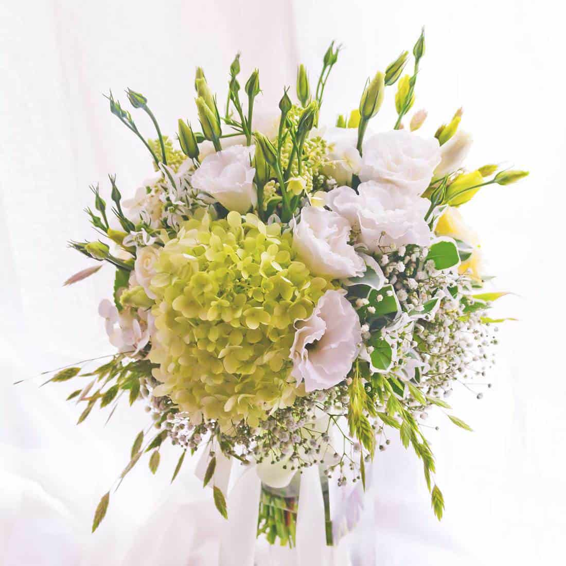 Beautiful summer bouquet of white hydrangeas and roses