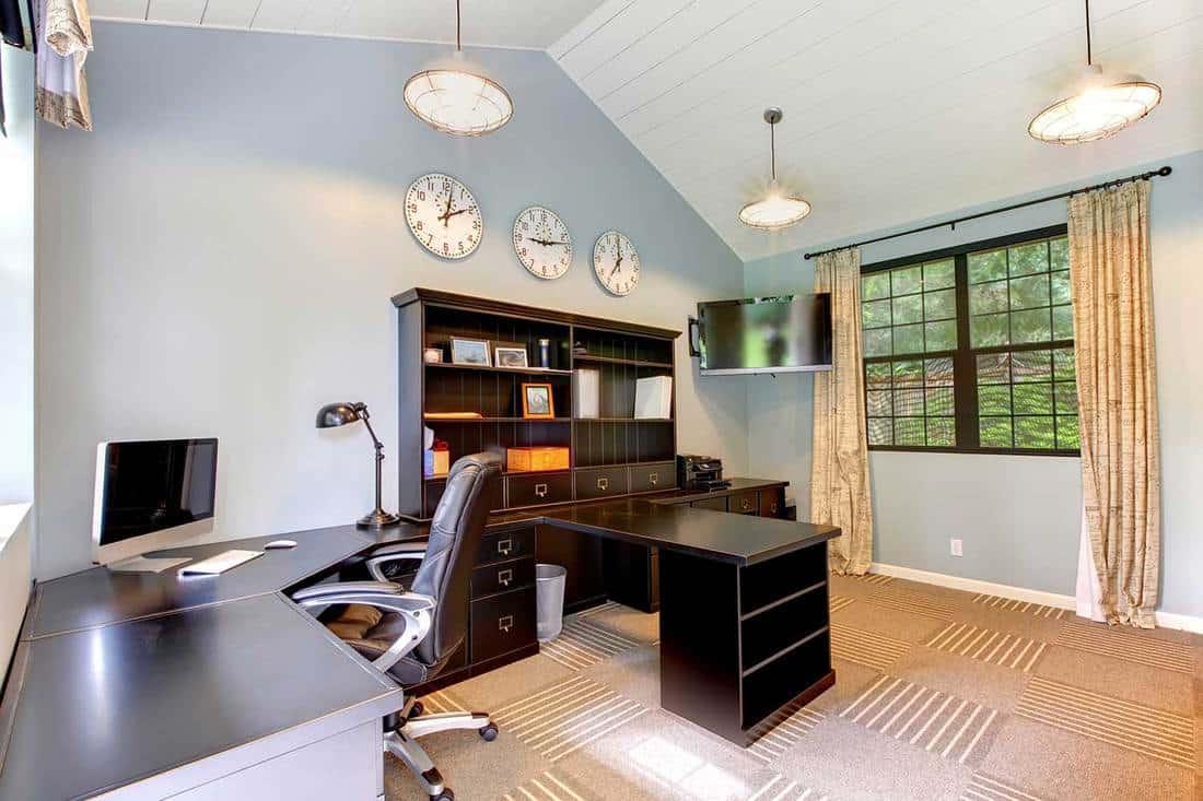 Blue modern home office interior design with dark brown furniture
