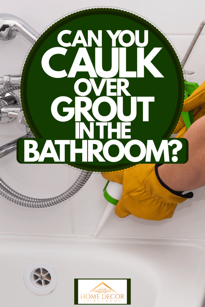 A worker applying caulk to the bathroom sink, Can You Caulk Over Grout In The Bathroom?