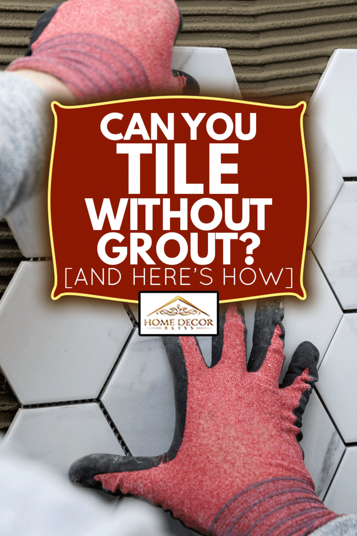 tiling - man laying marble texture hexagon tiles on the wall, Can You Tile Without Grout? [And Here's How]