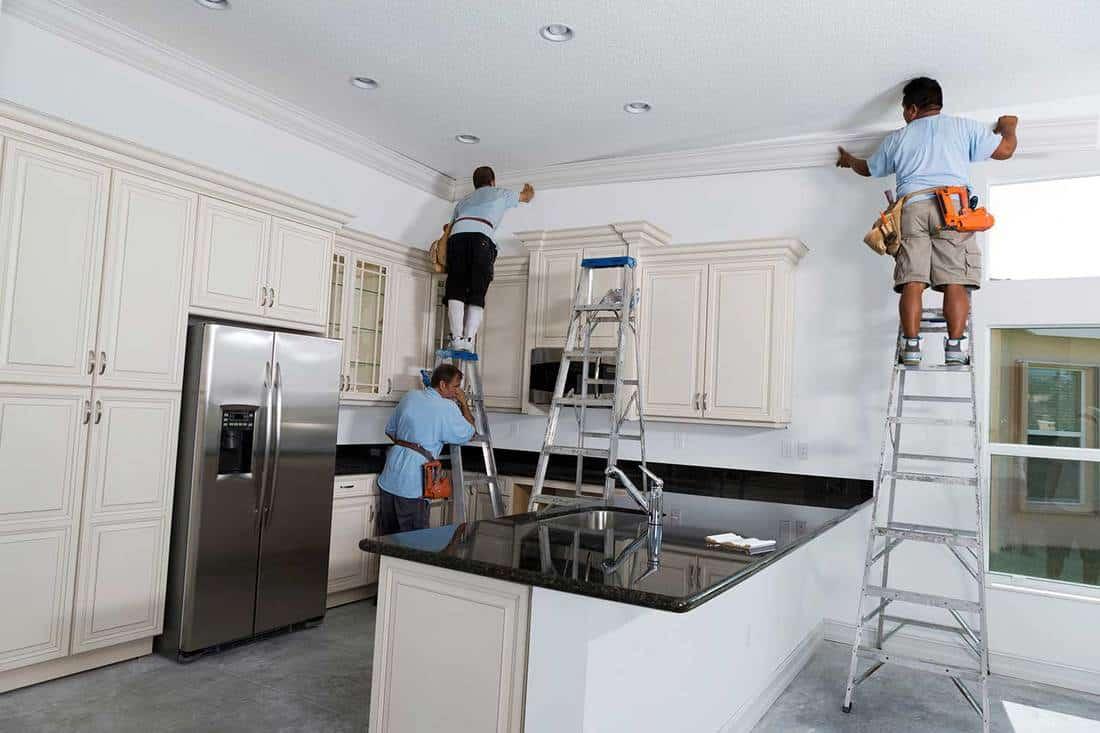 Carpenters installing crown molding