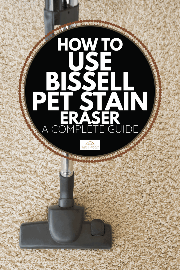 Carpet being hoovered by a hand held vacuum. How To Use Bissell Pet Stain Eraser [A Complete Guide]