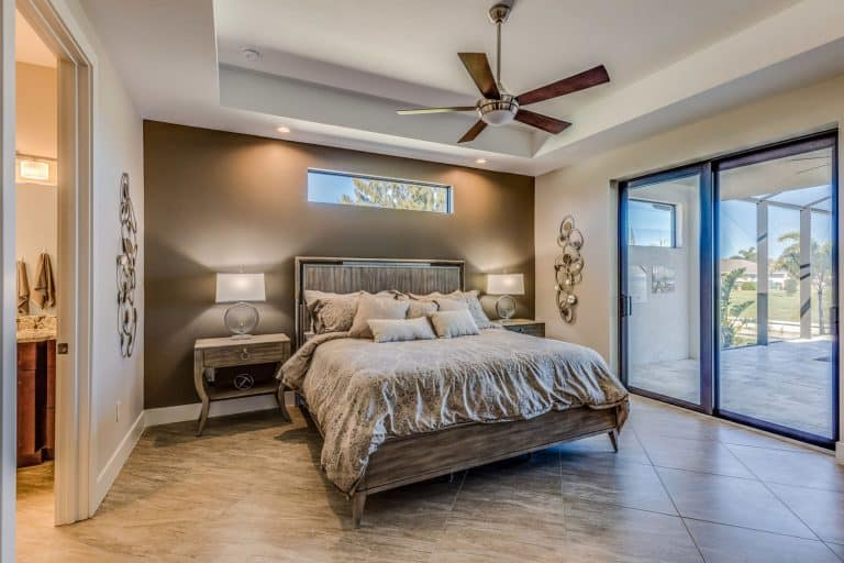 Ceiling fan and awning linear window above the bed, Should You Have Ceiling Fan In Your Bedroom?