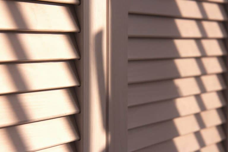 Contrasting shadows on classic white louvered doors, How To Clean A Louvered Door [3 Effective Methods]