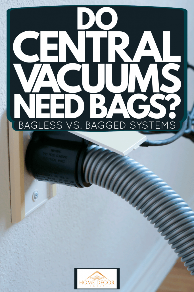 A big gray hose attached to the central vacuum system of the house, Do Central Vacuums Need Bags? [Bagless Vs. Bagged Systems]