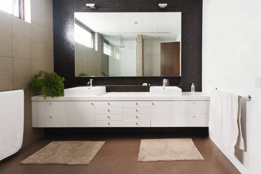 Double basin vanity and mirror in contemporary new large ensuite bathroom