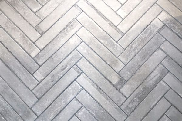 Read more about the article Is Bathroom Grout Waterproof Or Porous? [And Should You Seal It?]