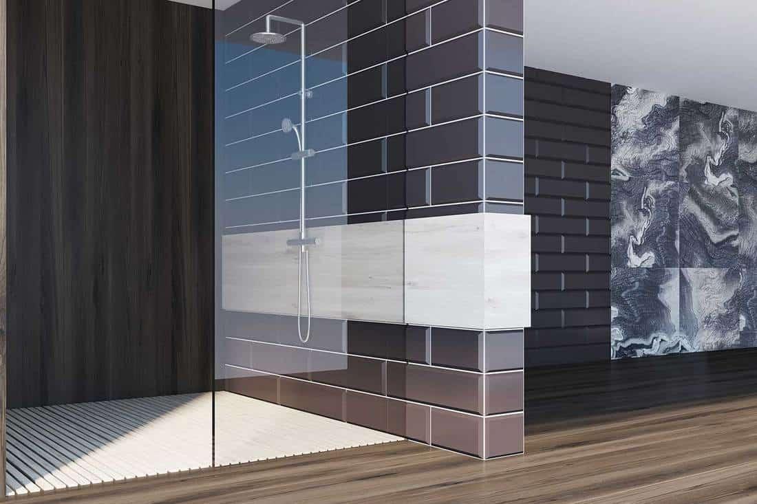 Gray marble bathroom and black brick shower