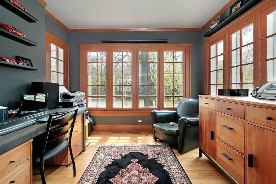Home office with wooden cabinets and hardwood floor