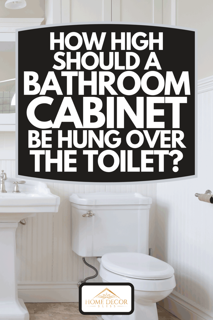 Modern and white washroom with toilet and cabinets, How High Should A Bathroom Cabinet Be Hung Over The Toilet?