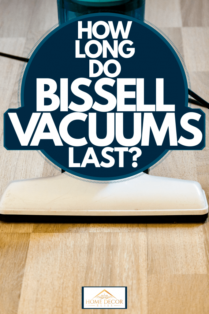 A blue cased vacuum cleaner vacuuming the wooden floor, How Long Do Bissell Vacuums Last?