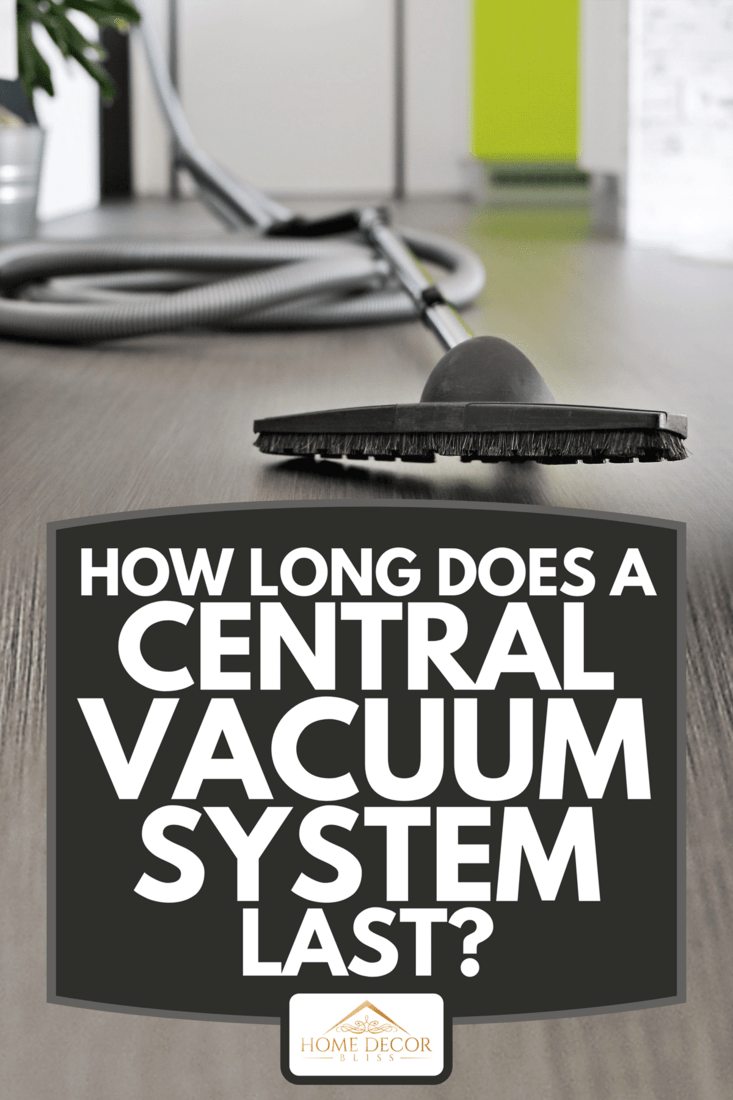 A central vacuum cleaner hose laid on the floor, How Long Does A Central Vacuum System Last?