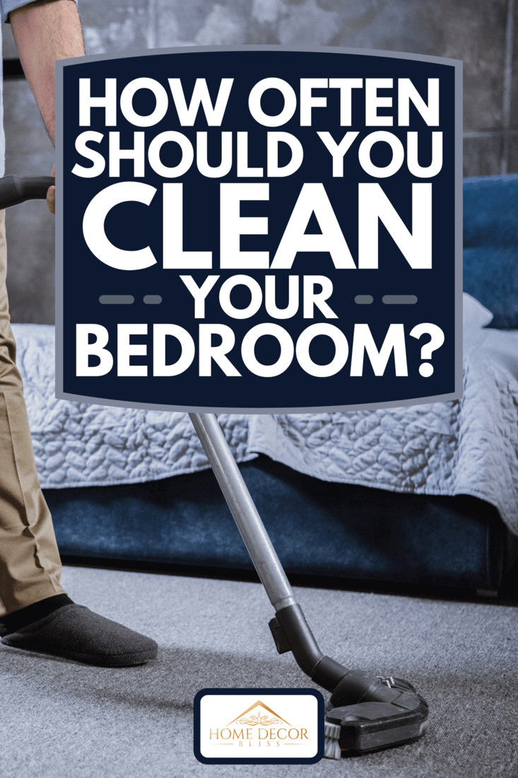 Man with vacuum cleaner cleaning carpet in bedroom, How Often Should You Clean Your Bedroom?