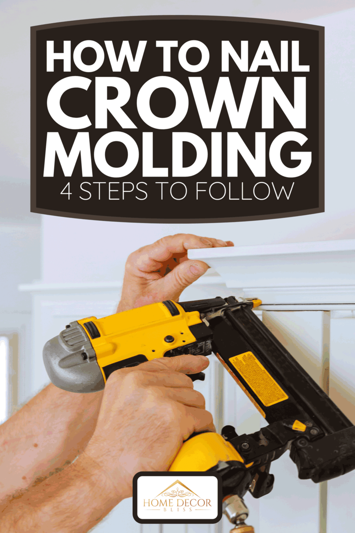 A carpenter brad using nail gun to crown moulding on kitchen cabinets framing trim, How To Nail Crown Molding [4 Steps To Follow]