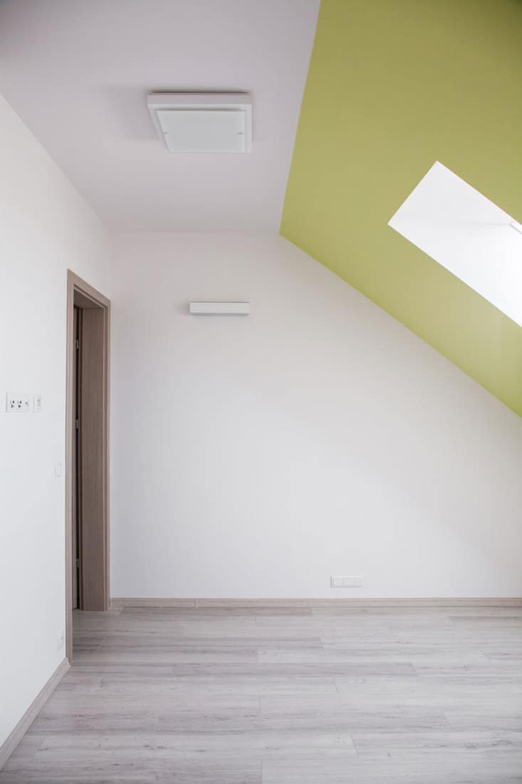 Interior of attic room with sloped ceiling