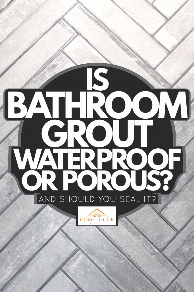 Gray bathroom tiles placed in a zigzag pattern, Is Bathroom Grout Waterproof Or Porous? [And Should You Seal It?]