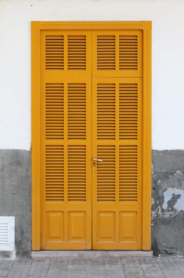 Italian style house entrance with shutters