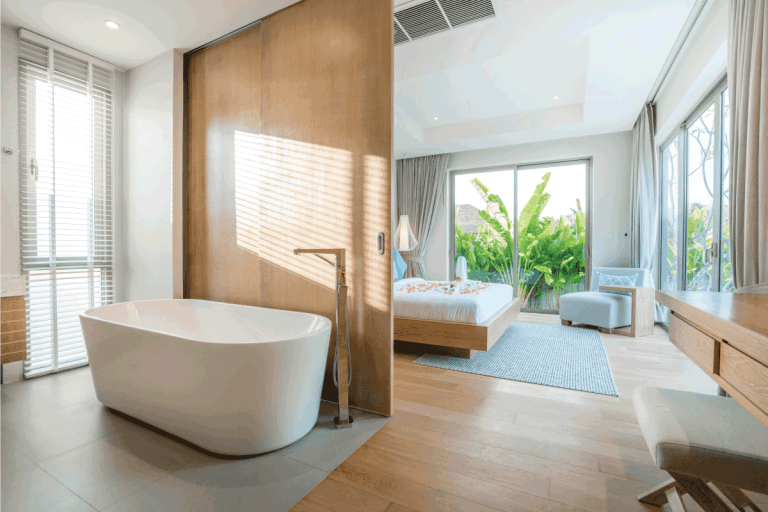 Luxury Interior design in bedroom of pool villa with cozy bed and build in bathtub with bright lighting. Do Master Bedrooms Typically Have Bathrooms