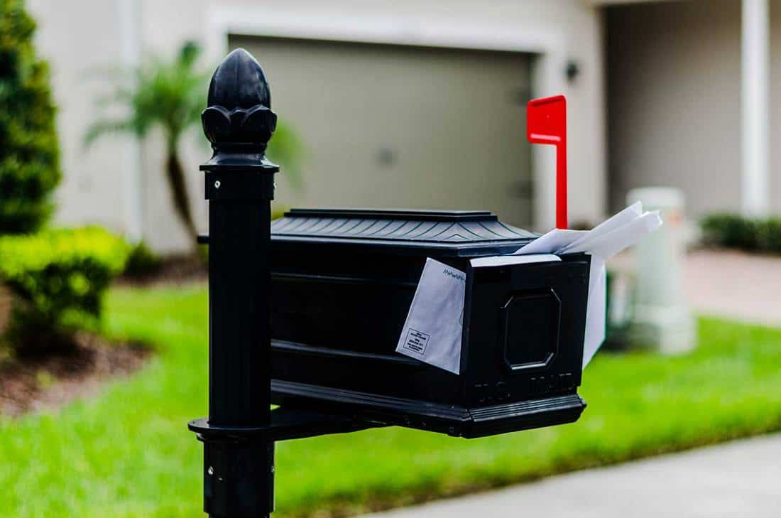 Mailbox with bills overflowing
