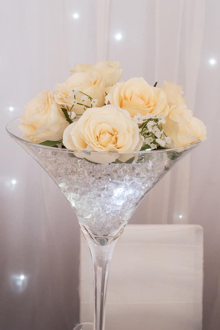 Martini Glass Table Decoration With Cream Flowers, Stars, Diamonds