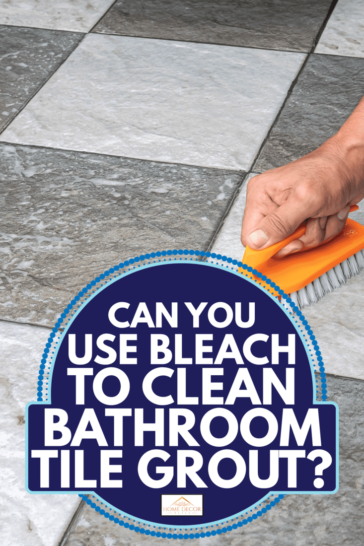 Men's hands are used to scrub tile floor and grout. Can You Use Bleach To Clean Bathroom Tile Grout