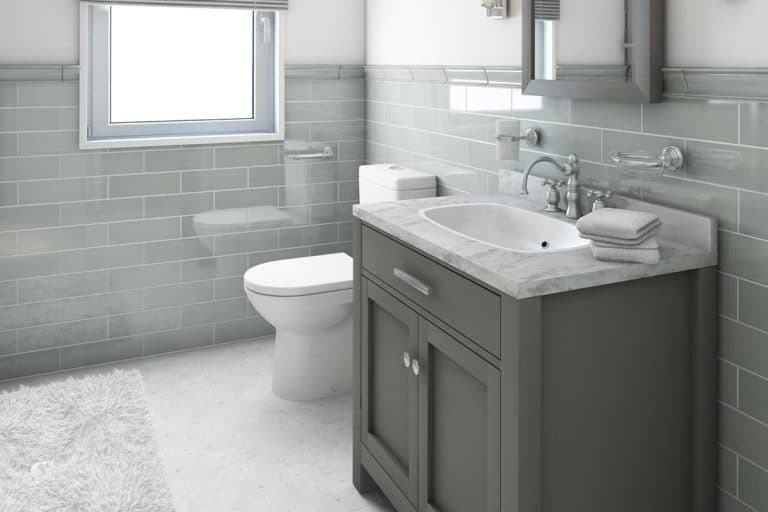 Modern bathroom in country house with gray interior, 11 Gorgeous Bathrooms With Gray Cabinets