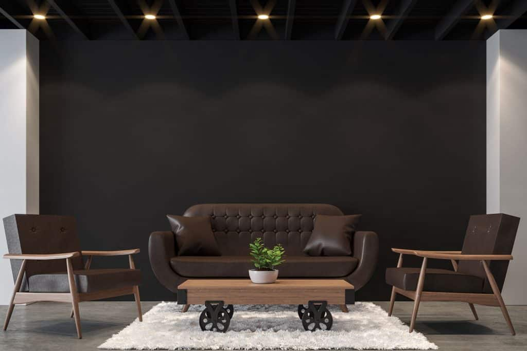 Modern design living room with leather sofa and two leather accent chairs