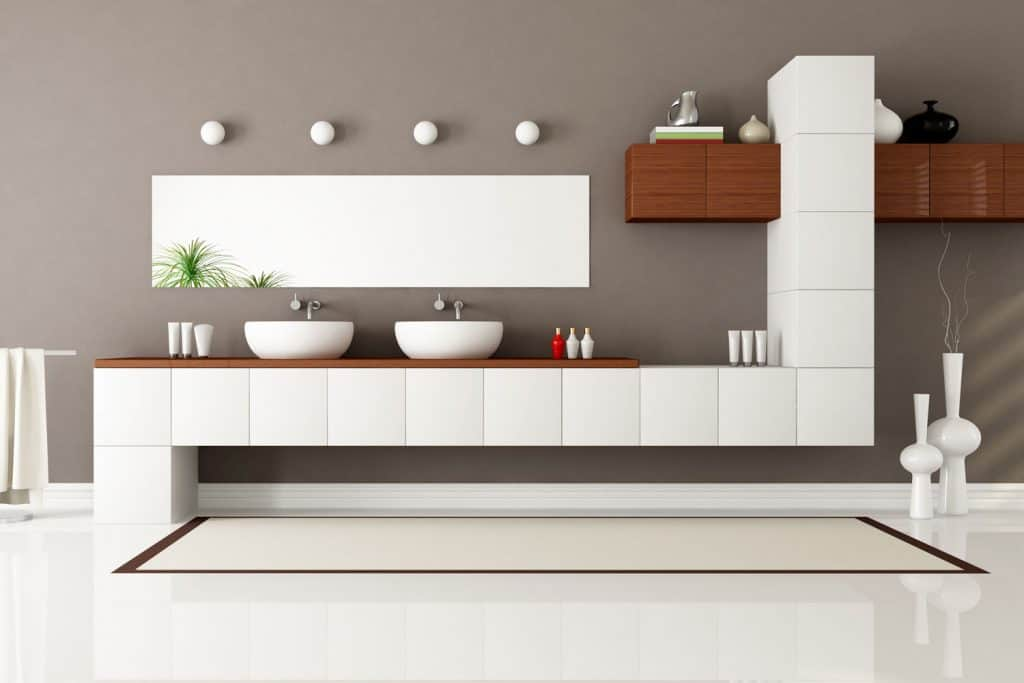 Modern inspired bathroom with an awesome inspired cabinetry with two sinks on the countertop