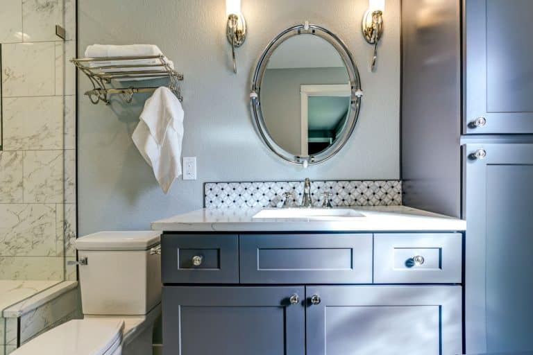 New blue bathroom design with Marble shower Surround and mosaic accent tiles, What Color Should Bathroom Cabinets Be?