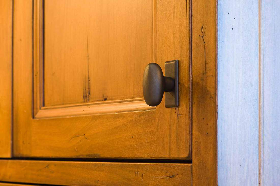 Oil rubbed bronze cabinet knob in a luxury home